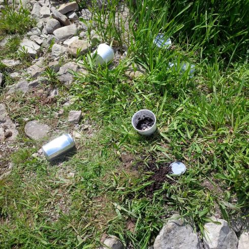 Garbage left on the side of the river by ignorant anglers