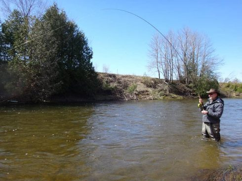 An angler fishing the Beaver river in the spring