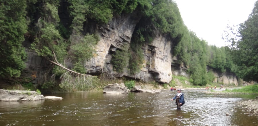 An angler fly fishing the Grand river in the Elora gorge