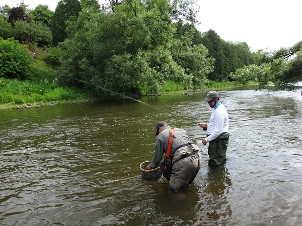 A top guide putting his client in the right spot for some good trout.